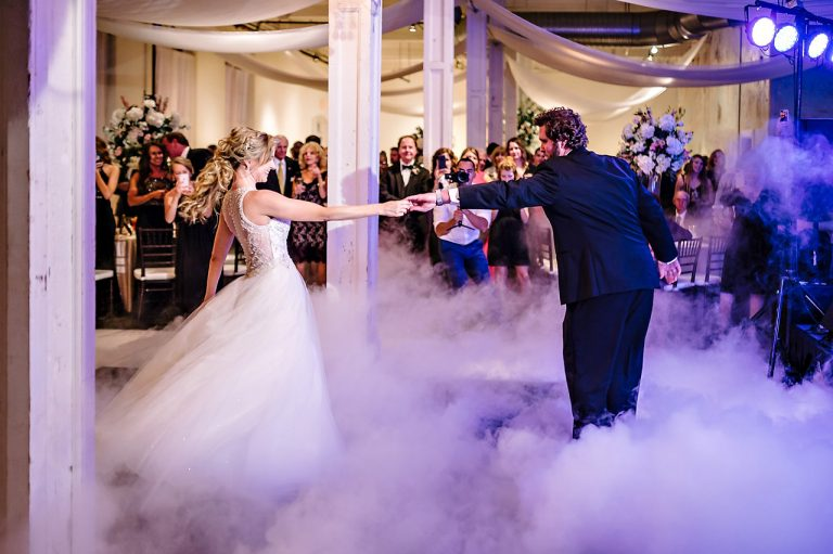 bride and groom first dance with fog